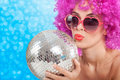 Beautiful Young Girl With A Pink Wig Holding A Disco Ball Royalty Free Stock Image - 46488306