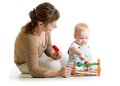 Kid And Mother Playing  With Musical Toy Royalty Free Stock Image - 46503556
