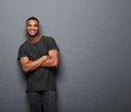 Happy Young Man Standing With Arms Crossed Royalty Free Stock Photos - 46512118