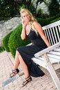 Sexy Blonde Woman Sitting On Bench Fashion Royalty Free Stock Image - 46526046