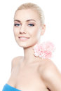 Beautiful Young Blond Woman With Pink Flower Stock Photos - 46538873