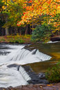 Waterfall In Autumn Forest Stock Photo - 46570350