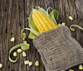 Grains Of Corn On A Cob And Sack On Wooden Table Stock Photos - 46574193