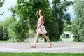Young Woman Walking On The Summer Park Royalty Free Stock Images - 46585079