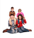 Parents Sit With Children On Shoulders Royalty Free Stock Photography - 4660127