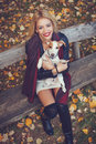 Attractive Young Woman Holding A Dog In Her Arms Royalty Free Stock Image - 46605356