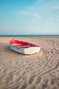 Small Fishing Boat On The Beach And Blue Sky Stock Images - 46610774