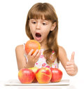 Little Girl With Apples Is Showing Thumb Up Sign Royalty Free Stock Image - 46618716