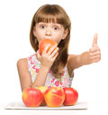 Little Girl With Apples Is Showing Thumb Up Sign Stock Photo - 46618720