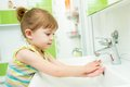 Cute Little Girl Washing Her Hands In Bathroom Royalty Free Stock Photos - 46643728