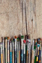 Row Of Artist Paintbrushes On Old Wooden Table Royalty Free Stock Photos - 46648738