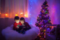 Two Boys, Playing On Tablet At Home, Next To Christmas Tree Stock Photos - 46654143