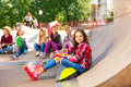 Girl Wears In-line Skates Sits In Front With Mates Stock Photos - 46654903