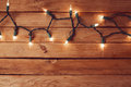 Christmas Background With Empty Wooden Table And Christmas Lights Stock Images - 46664004