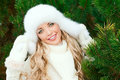 Woman In A Hat, Mittens, Scarves, Sweaters, Fur In Winter Fir Forest Royalty Free Stock Photography - 46673237