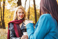 Two Women Drinking Coffee In The Park Royalty Free Stock Photography - 46688547