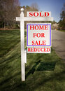 Real Estate Sign With Sold And Reduced Royalty Free Stock Photography - 4673777