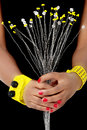 Hands Of An African Woman Hold White And Yellow Beaded Flowers Royalty Free Stock Photo - 46704515