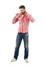 Young Fashionable Guy Holding Collar On His Plaid Shirt Royalty Free Stock Images - 46715849