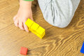 Child Is Playing With Multicolored Cubes On Wooden Floor Royalty Free Stock Photos - 46735788
