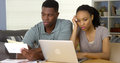 Frustrated Young Black Couple Going Over Bills And Finances Online Royalty Free Stock Photography - 46737607
