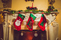 Toned Photo Of Three Red Christmas Socks Hanging On Fireplace Stock Images - 46737754