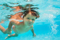 Close Up View Of Small Boy Swimming Under Water Stock Photography - 46793162