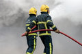 Fire Fighters Fighting Fire With Hose Royalty Free Stock Photo - 46796825