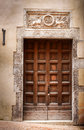 Ancient Wooden Door Of A Historic Building In Perugia (Tuscany, Italy) Stock Photo - 46828010