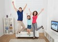 Portrait Of Excited Family Jumping At Home Stock Photo - 46845730