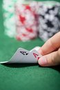 Poker Player Checking A Pair Of Aces Royalty Free Stock Image - 46851386