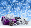 Purple Christmas Package , Gift Of A Silver Ribbon. Jingle Bells , Silver Christmas Balls And Christmas Stars Put On Snow. Abstrac Stock Photography - 46862572
