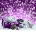Purple Christmas Package , Gift Of A Silver Ribbon. Jingle Bells , Silver Christmas Balls And Christmas Stars Put On Snow. Abstrac Royalty Free Stock Photos - 46862578