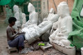 Burmese Man Carving A Large Marble Buddha Statue. Stock Photo - 46868990
