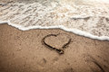 Toned Photo Of Heart Drawn On Sand Being Washed By Wave Stock Images - 46915644