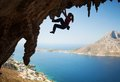 Silhouette Of Young Female Rock Climber On A Cliff Stock Photos - 46935803