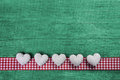 Green Wooden Background With Hearts On A Red White Checked Frame Stock Images - 46943854