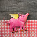 Flying Happy Pink Pig On Wooden Old Checked Background. Royalty Free Stock Photo - 46944085