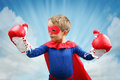 Superhero Child With Boxing Gloves Stock Image - 46948361