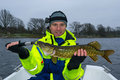Happy Angler With Pike Royalty Free Stock Photography - 46948897