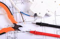 Cables Of Multimeter, Pliers, Electric Fuse And Wire On Construction Drawing Royalty Free Stock Photos - 46961228