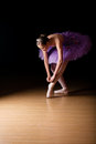 Young Female Ballerina Adjusting Her Shoes Royalty Free Stock Photos - 46978538