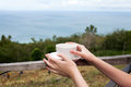A Cup In The Hands And Beautiful Seaview Stock Photography - 46997202