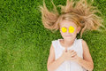 One Happy Little Girl Lying On The Grass Stock Image - 46997881