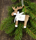 Vintage Wooden Reindeer Christmas Decoration And Fir Tree Branch Stock Image - 46998451
