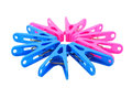 Pink And Blue Clothespin On White Stock Images - 46999444