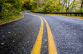 Wet Road In Mountains In Fall Royalty Free Stock Photos - 47023058