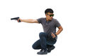 Portrait Of Young Man With Gun On White Background Stock Photo - 47030020