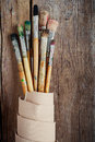 Artist Paintbrushes And Roll Of Canvas Stock Photo - 47039930