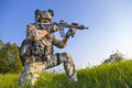 American Soldier Aiming His Rifle On Blue Sky Background Stock Images - 47052784